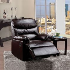 """Arcadia brown bonded leather standard motion reclining recliner chair with overstuffed seats and arms. This recliner features a bonded leather upholstery with a release latch on the side of the recliner, this is a manual recliner you need to push the footrest back to lock it in. Recliner measures 38"""" x 35"""" x 40"""" H. Some assembly may be required."""