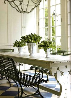 Kitchen table. Makes me think the kitchen opens up to a terrace or patio.  So French haute. Love the checkerboard flooring!