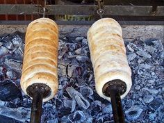 Chimney cake roasted over charcoal fire Hungarian Desserts, Chimney Cake, Cakes And More, Rolling Pin, Breads, Om, Charcoal, Roast, Food And Drink