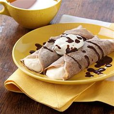 Tiramisu Crepes Recipe -Delicate crepes, filled with creamy Mascarpone cheese and laced with vanilla and a hint of coffee liqueur, make for a mouthwatering morning treat. It's special in every way. —Karen S. Shelton, Collierville, Tennessee