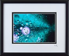 Oil Orbs – Framed   Oil Orbs - Framed To create this image, I placed cooking oil, water, and a little bit of food coloring into a brushed-metal condiment cup, then stirred vigorously and photographed the result through a digital field microscope. This image is 5x7, double matted and framed to 8x10. The inner mat is black, the outer mat is white, and the frame is black.  http://www.finelifeart.com/oil-orbs-framed-2/