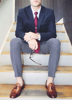 Shop this look on Lookastic:  http://lookastic.com/men/looks/dress-shirt-tie-pocket-square-blazer-dress-pants-tassel-loafers/9668  — White Vertical Striped Dress Shirt  — Purple Silk Tie  — Navy Polka Dot Pocket Square  — Navy Wool Blazer  — Navy and White Polka Dot Dress Pants  — Brown Leather Tassel Loafers