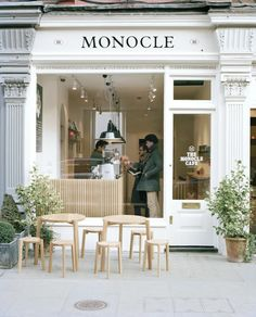 Monocle Cafe, white, bit of black and greenery alway a classic