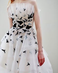Come fly away. Velvet and sequin seagulls embroidered on a Pre-Fall tulle gown. #oscardelarenta