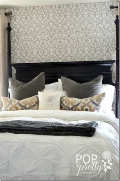 Our gorgeous scroll wallpaper in a sophisticated master bedroom. See the full reveal at http://apopofpretty.com/wallpaper-accent-wall-bedroom/