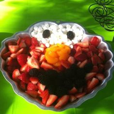 Simple fruit display using an Elmo cake pan. The whites of the eyes are mini marshmallows. Elmo Fruit Tray. Elmo Fruit Face. Elmo Fruit Platter.