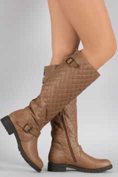 """Buckled Quilted Shaft Round Toe Riding Knee High Boots. Description These  knee high boots  features a quilted design shaft with decorative buckle strap detail, back zipper trim, round toe silhouette, and low block heel. Finished with cushioned insole, soft interior lining, and full-length side zipper closure for easy on/off.Material: Vegan Leather (man-made)Sole: Rubber  Measurement Heel Height: 1.25"""" (approx)Shaft Length: 16.5"""" (including heel)Top Opening Circumference: 14.5""""…"""