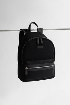 This gorgeous backpack is built with neoprene and vegan leather. It is perfect for travelling, work, back to school, university, and as a changing bag.