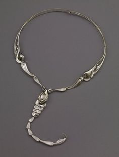 Silver scorpion necklace. Made in articulated segments of varying size, the body and tail unhooks from the main necklace which can be worn on its own.