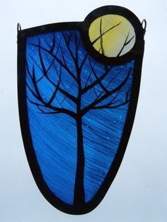 Winter tree in moonlight stained glass designed and created by Sarah Roberts Stained Glass Art    https://www.facebook.com/sarahrobertsstainedglassart