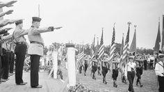 Bund leader Fritz Julius Kuhn salutes his comrades.