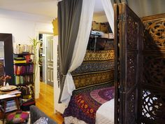 Use of 2 wardrobes  at foot of bed to make a bed nook in a studio apt. Guest bed space in next house?