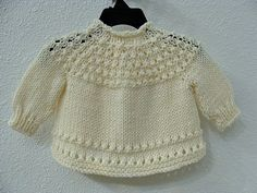 Hand Knitted Baby Sweater Cream    I enjoyed picking up my knitting needles and creating this sweet baby girl sweater.    The baby sweater is soft to the touch and delicate for that new baby girl.    For babys comfort, no buttons were used and there is a tie closure at the neck.    I used Loops and Threads Impeccable acrylic yarn and the color is Aran/Cream.    Sleeve measures from end of decor on yoke to end of sleeve 6 long.    Across from under arm to the other under arm measures appr...