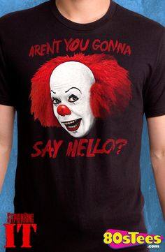 "Pennywise Say Hello T-Shirt: It Mens T-Shirt This not so popular antagonist is artfully illustrated and designed. Perfect to wear when watching the ""It"" video in this men's fashion."