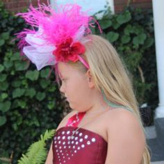 Head piece made for daughters dress up party using headband and feathers