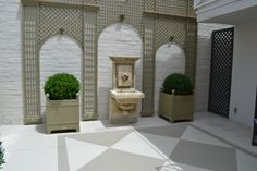 Treillage and planters by fountain