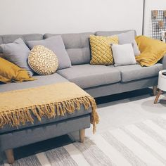 When a beautiful mustard pillow case pairs up with an elegant grey couch the outcome is a classy modern! @cheapandbeautiful
