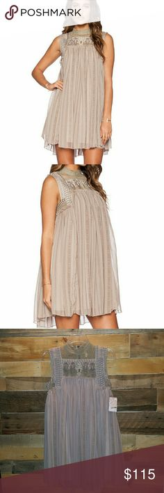 """MAKE OFFER!! NWT FREE PEOPLE BABYLON DRESS BRAND NEW WITH TAGS!! REASONABLE OFFERS ONLY PLEASE!! WELL WORTH IT!! GORGEOUS DRESS!! FREE PEOPLE """"PENNY GEORGETTE BABYLON DRESS"""" COLOR STONE COMBO SIZE SMALL RETAIL $165 SHELL & LINING 100% POLYESTER TRIM 100% NYLON HIGH NECKLINE LACE & INTRICATE EMBROIDERY EXPOSED BACK ZIPPER CLOSURE SLEEVELESS MINI LENGTH *NO TRADES NO MODELING NO RETURNS* *ASK QUESTIONS PLEASE* Free People Dresses Mini"""