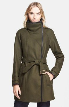 chic stand collar begins a military-inspired coat detailed with leather trim tracing the asymmetrical front. The raglan-sleeve style gets signature polish from epaulets, burnished goldtone hardware...