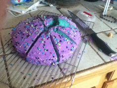 Party cake made by 12 year old girls. 1 box white cake mix- 1 can white or purple frosting (if white, will need purple food coloring). Colorful confetti sprinkles: colors used: green, blue, black, purple. Make cake batter. Before baking, add 10 drops of blue food coloring. Bake cake as directed. When cool (may need to put in freezer for a few minutes to cool down), frost with purple icing. Then add sprinkles. PARTY CAKE