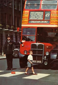 A London bus stops for a (much smaller) London bus.