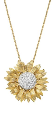 Asprey gold and diamond sunflower pendant. Also converts to a brooch - a sunny, shiny, two-for-one.