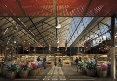 Tramshed Revival. Slender structure, sawtooth roof, suspended light tracks