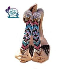 Showman Aluminum Sure Grip Stirrups with genuine Swarovski rhinestones in brilliant Crystal AB, turquoise, pink and brown. These crystals have an iridescent shine and sparkle that rivals real diamonds. Rhinestones are attached with an industrial strength, weatherproof glue and will last for years without losing a stone with proper care! Western stirrups measure 3 neck, 4 1/2 wide and 2 1/4 tread. Leather wrapped, rubber tread.   Stirrups are custom made at time of order please allow...