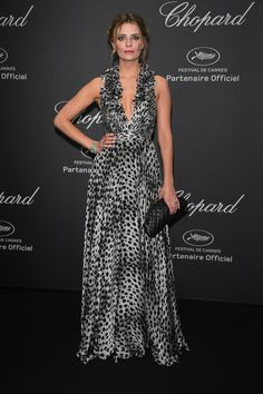 16 May Mischa Barton chose a low-cut monochrome gown to the event.   - HarpersBAZAAR.co.uk