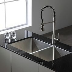 Replace your worn-out kitchen sink with this stylish stainless steel sink from Kraus. Featuring an extra-deep design to accommodate large dishes, this stainless steel double sink incorporates soundpro