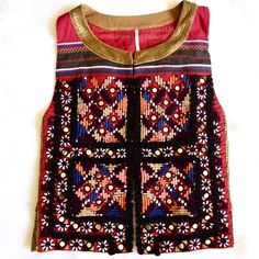 """FREE PEOPLE Vest Embroidered Sequin Bohemian Top Size Large. New without tags.  $398 Retail + Tax.   Gorgeous bohemian vest with mirror embellishments.  Gold sequins cover the back with ruffle trim. Clasp closure at top.  Measurements for Large: Length: 22"""" Armhole Drop: 12""""   ❗️ Please - no trades, PP, holds, or Modeling.    Bundle 2+ items for a 20% discount!    Stop by my closet for even more items from this brand!  ✔️ Items are priced to sell, however reasonable offers will be considered…"""