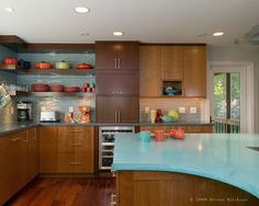 Medium wood cabinets, paired with a really cool turquoise formica and tile backsplash.