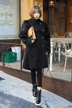 Fur Sleeved Double-Breasted CoatDramatic and definitely eye-catching, this fur sleeved coat is sure to get the crowd