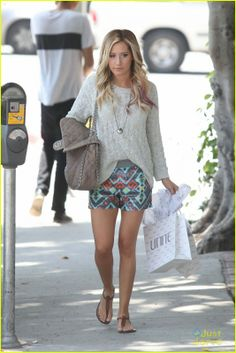 Ashley Tisdale wearing Chanel Chain Around Maxi in Taupe Vanessa Mooney Keepsake Bottle Necklace Sam Edelman Gigi Sandal Free People Sequin Board Shorts Free People Beach Cable Pullover