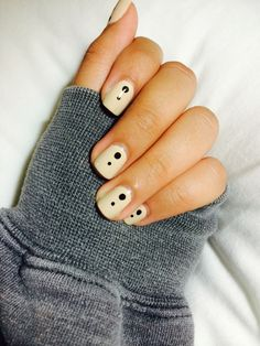 Minimalist nails. Beige with black dot design