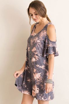 Tie-dye print rayon open shoulder tent dress featuring ruffled sleeves in lightweight jersey. Content + Care: 96% Rayon 4% Spandex Machine Washable