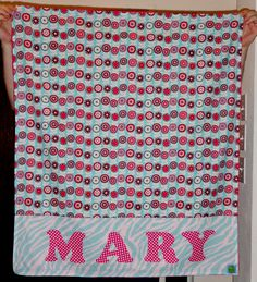 I made this blanket as a baby gift for the wonderful teacher that had two of my girls in 2nd grade. (And she survived both of them! LOL) The back is bright pink minky. I hope baby Mary will get lots of use from it!