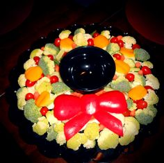 Vegetable tray bouquet for Christmas dinner! The bow is made of red peppers. #vegetables #Christmas #food