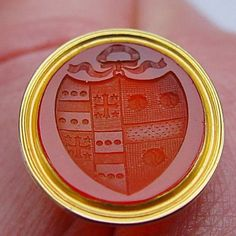 Fine quality antique Victorian cornelian agate fob seal carved with an intaglio of an armorial crest including what appear to be 3 tiger heads or certainly large cat heads. The intaglio is set in a decorative 18 Carat gold mount (not marked, but acid tested).  It measures approx. almost 1 x almost 7/8 x just over 1 inch   (1 inch = 25mm) $240 #intaglio