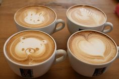 Latte art of a teddy bear, a bunny, a heart, and a leaf. I so want to learn how to do this.