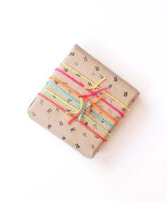 diy gift wrap with stamp and yarn