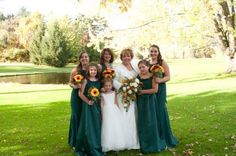 For a fall look this bride chose emerald colored dresses for her girls and they carried bouquets with Gerbera daisies, mums and other assorted flowers.  The bride carried a cascading bouquet in muted colors.  Miller wedding, photo by Dan Cooper.