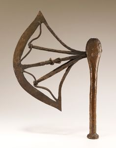 Iron axe with wood handle covered with copper sheet. Axe blade is curved with a central spoke with a full figure, and two shorter side spokes connect to a wavy band. Battle Axe, Copper Sheets, National Museum, African Art, Objects, Congo, Blade, Connect, Collections