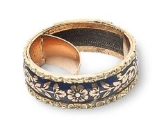 mourning ring in gold with black enamel featuring  a secret compartment garnished with woven hair (shown open)