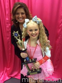 [S5E12] Jojo Siwa with Abby Lee Miller in the dressing room after the awards ceremony.