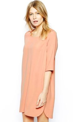 Made from a woven poly fabric. Crew neckline. Dipped hem. Relaxed, shift style. Regular fit. Fabric: 1...