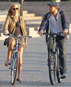 Leonardo DiCaprio and girlfriend Erin Heatherton ride bicycles in downtown Manhattan after having dinner