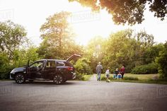 Open Black Electric Car With Family Walking In Park Photography , Park Photography, Electric Car, Video Camera, The Outsiders, Stock Photos, Walking, Vehicles, Videos, Black