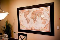 Huge map in the dining room. Shawni from 71 Toes always talks about how much they love this! It inspires discussion about things going on in the world, places they have been & places they would like to go. They mark places that at least one of them have been on the map with a little red dot and hope to encourage their children to love the world & to travel. LOVE THIS IDEA!