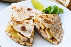 Kid-friendly Chicken Apple Quesadillas! Toasted flour tortillas with melted cheese, apple slices, chicken, and salsa.